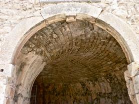 Concave, curving brick ceiling