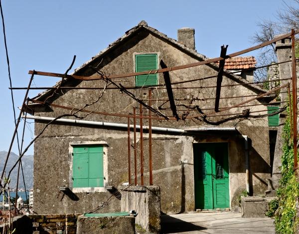 Turquoise door, shutters, kotor, montenegro