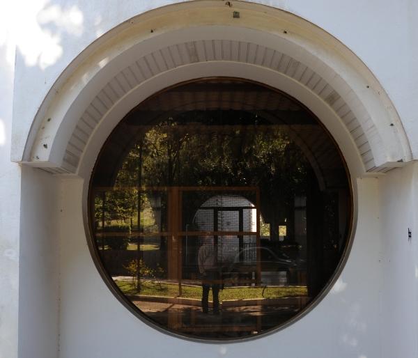 Abandoned hotel, Montenegro, circle window